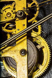 Gears and other parts of an old clock mechanism.  Clock circa 1910.