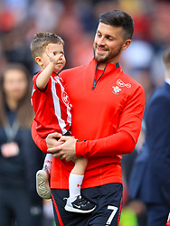 Southampton's Shane Long and son on the pitch during the appreciation lap
