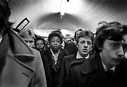 Crowded Holborn tube station, waiting for the lift. Coming and Going is a project commissioned by the Museum of London for photographer Barry Lewis in 1976 to document the transport system as it is used by passengers and commuters using public transport by trains, tubes and buses in London, UK.