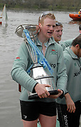 Putney, London,  Fred GILL, Stroke, CUBC, Cambridge Blue Boat Crew, celebrates, with Boat Race Trophy, 156th University Boat Race, River Thames, between Putney and Chiswick, on the Championship Course.  Saturday  03/04/2010 [Mandatory Credit Karon Phillips/Intersport Images]<br /> CUBC Crew, Bow - Rob WEITEMEYER, Geoff ROTH, George NASH, Peter McCELLAND, Deaglan McEACHERN, Henry PELLY, Derek RASMUSSEN, Stroke - Fred GILL and Cox - Ted RANDOLPH