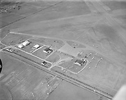 """Y-530407C-2. Aerials Hillsboro, Oregon airport. April 7, 1953. """"Oregonian aerial photo...shows Hillsboro's 285-acre $545,000 airport with its two 4050-foot paved runways and city in background. Air force engineers considered field 'most likely' of sites examined for fighter-interceptor base if squadron were moved from Portland, yeilding to port's protests."""" Caption published in Oregonian April 8, 1953"""