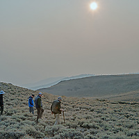 An archaeology team walks near an ancient native settlement in the White Mountains of California.