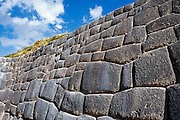 """Around 1450 AD, the Incas crafted impressive stone walls at the archaeological site of Tambomachay (El Baño del Inca), 8 km north of Cuzco, in Peru, South America. Tampumachay means """"collective housing resting place"""" in Quechua language. The Incas perfected stonecraft to an amazing degree."""