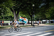 WASHINGTON, DC -- 8/28/20 -- A man flying a Justice for George Floyd flag rides on Constitution Ave<br /> The 57th Anniversary March on Washington drew thousands to the National Mall to hear activists speak at the Lincoln Memorial .…by André Chung #_AC20157