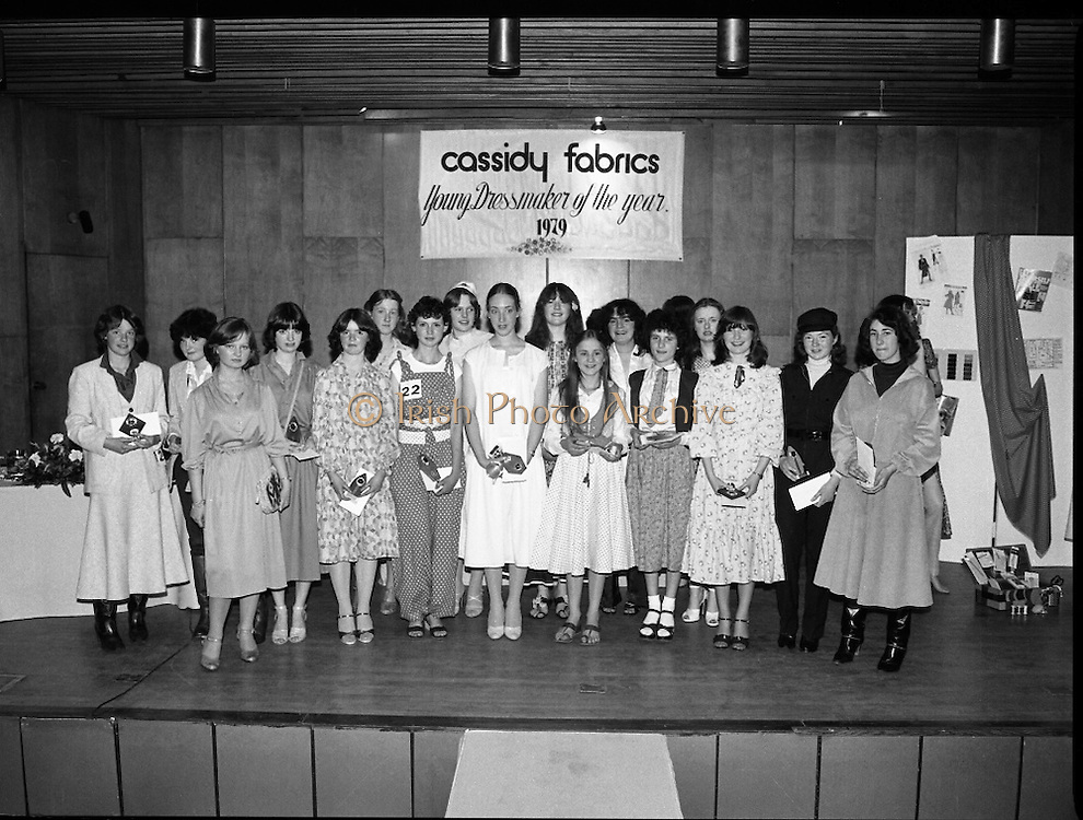 Young Dress Designer of the Year.     (M75).1979..22.05.1979..05.22.1979..22nd May 1979..The Cassidy Fabrics sponsored Young Dress Designer of the Year, make and model competition was held today in Liberty Hall,Dublin. The overall winner of the competition was Ms Marianne Byrne (15),Cabinteely,Co Dublin. Ms Byrne is a pupil at the Cabinteely Community School...Picture shows all the award winners in the Young Dress Designer of the Year competition.The overall winner Ms Marianne Byrne takes centre stage.