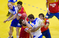 Uros Zorman of Slovenia between Joan Canellas of Spain and Jorge Maqueda of Spain during handball match between Spain and Slovenia in  Main Round of 10th EHF European Handball Championship Serbia 2012, on January 25, 2012 in Spens Hall, Novi Sad, Serbia. (Photo By Vid Ponikvar / Sportida.com)