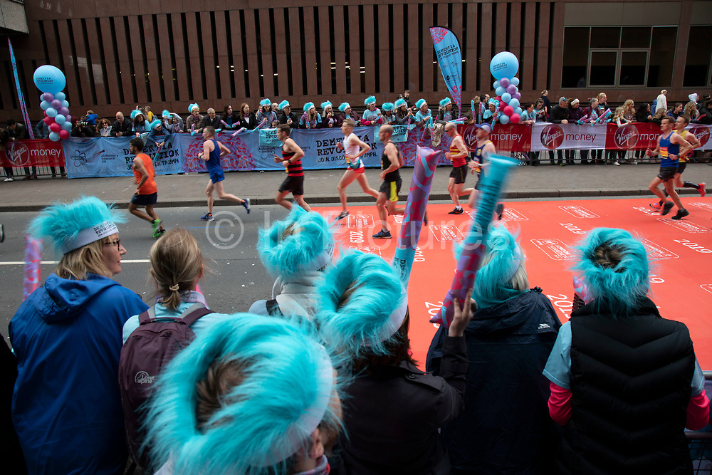 Charity Dementia Revolution taking part in the London Marathon on 28th April 2019 in London, England, United Kingdom. The London Marathon, presently known through sponsorship as the Virgin Money London Marathon, is a long-distance running event. The event was first run in 1981 and has been held in the spring of every year since. The race is mainly known for ebing a public race where ordinary people can challenge themsleves while raising great amounts of money for various charities.