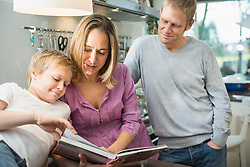 Family watching cook book