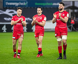 Alex Lewington of Saracens, with team-mates Calum Clark and Alex Lozowski applaud the fans<br /> <br /> Photographer Simon King/Replay Images<br /> <br /> European Rugby Champions Cup Round 5 - Ospreys v Saracens - Saturday 11th January 2020 - Liberty Stadium - Swansea<br /> <br /> World Copyright © Replay Images . All rights reserved. info@replayimages.co.uk - http://replayimages.co.uk