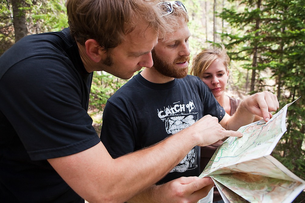 Hikers study their topo map along the trail up Baker Gulch in the Never Summer Wilderness, Colorado.