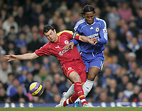 Photo: Lee Earle.<br /> Chelsea v Reading. The Barclays Premiership. 26/12/2006. Chelsea's Didier Drogba (R) battles with Graeme Murty.
