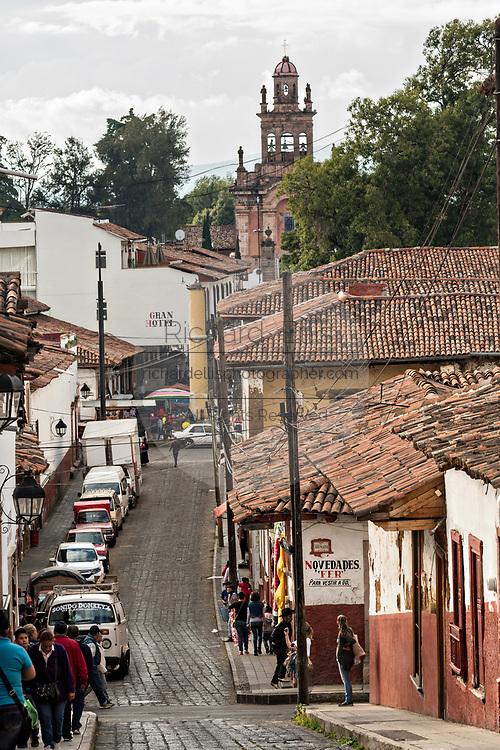 The Parroquia del Santuario de Guadalupe church rises above the tile roofs in Patzcuaro, Michoacan, Mexico.