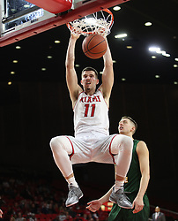 November 14, 2017 - Oxford, Ohio, U.S - Miami (Oh) Redhawks forward Logan McLane (11) puts down a dunk on Tue Nov 14, 2017 . During play with Wright State Raiders in Oxford,Ohio. (Credit Image: © Ernest Coleman via ZUMA Wire)