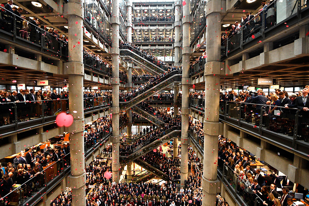 Staff line the atrium as poppies fall during a Armistice Commemoration Service at Lloyds of London in London, Britain, 09 November 2018. The 11 November 2018 marks 100 years since the end of the First World War