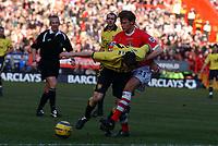 Photo: Olly Greenwood.<br />Charlton Athletic v Aston Villa. The Barclays Premiership. 25/02/2006. <br />Aston Villa's James Millner is held back by Charlton's Jonathan Spector.