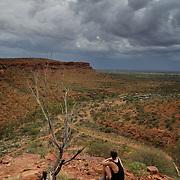 Kings Canyon in Northern Territories. Girl walking on the top of the Kings Canyon