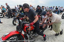 Jeff Decker on his 1929 Harley-Davidson JD passes through the start with the help of Bill Buckingham and Sean Brayton on the sands of Daytona Beach at the beginning of stage 1 of the Motorcycle Cannonball Cross-Country Endurance Run, which on this day ran from Daytona Beach to Lake City, FL., USA. Friday, September 5, 2014.  Photography ©2014 Michael Lichter.
