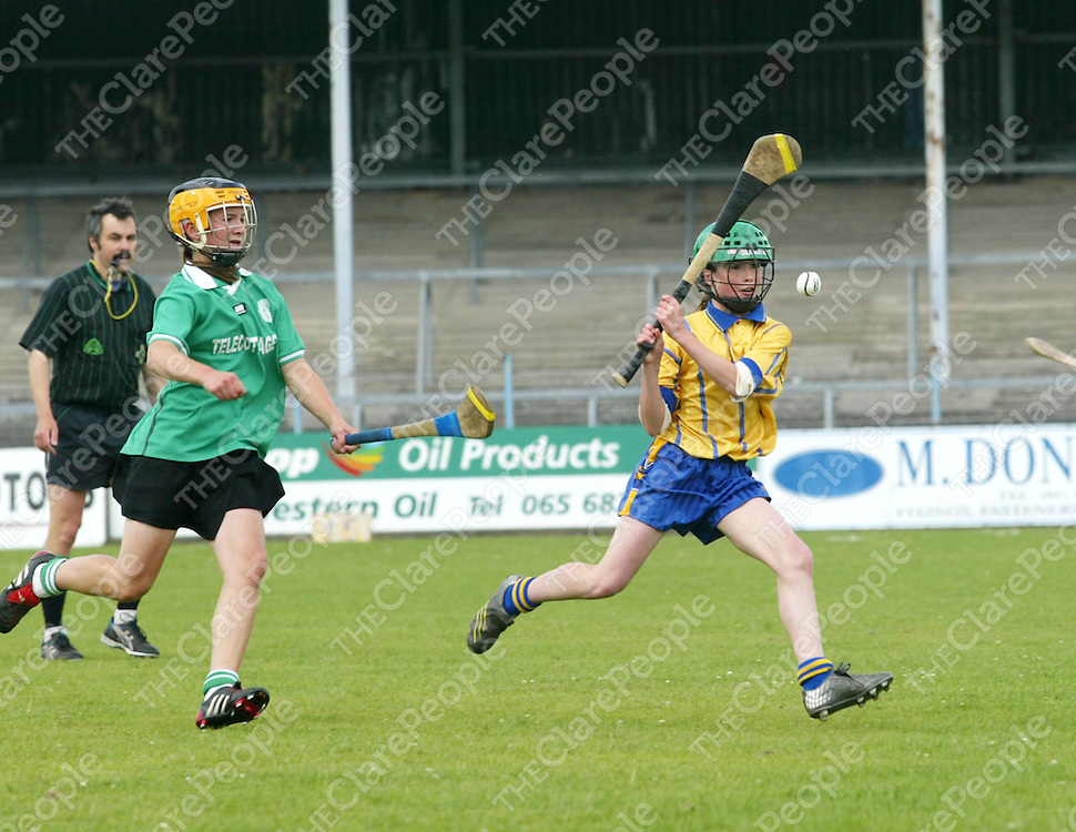 Clare Primary Schools Finals in Camogie between Ruan/ Toonagh & Scariff National Schools. Pictured are Ruan/ Toonagh's Lisa O'Connor & Scariff's Susan Fahy battling it out for the ball. Pic. Emma Jervis/ Press 22.