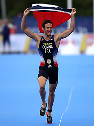 France's Dorian Coninx celebrates bringing his team home to win the Triathlon Mixed team relay during day ten of the 2018 European Championships at Strathclyde Country Park, Lanarkshire.