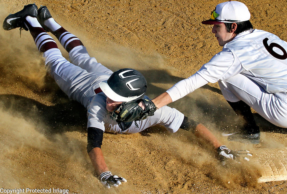 Scotts Valley High's Riley Hilton gets a face full of dust – and of third baseman Jack Peoples' baseball mitt - as he is tagged out trying to steal third during Scotts Valley's Santa Cruz Coast Athletic League win over St. Francis Central Coast Catholic High School St. Francis High in Watsonville, California. Hilton, who pitched the game for the Falcons, got the last laugh; recording a complete game, 6-2 victory from the mound.<br /> Photo by Shmuel Thaler <br /> shmuel_thaler@yahoo.com www.shmuelthaler.com