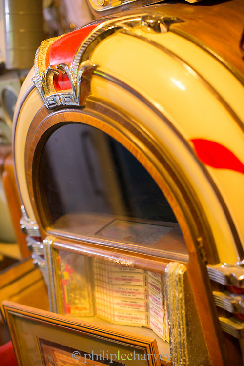 Detail of yellow jukebox standing in antique market in Casablanca, Morocco