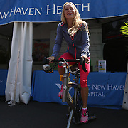 August 16, 2014, New Haven, CT:<br /> Caroline Wozniacki bikes on a spin bike in front of the Yale New Haven Health booth during WTA All-Access Hour on day three of the 2014 Connecticut Open at the Yale University Tennis Center in New Haven, Connecticut Sunday, August 17, 2014.<br /> (Photo by Billie Weiss/Connecticut Open)