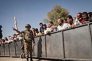 Syrian Kurdish refugees wait to return to their native Kobani, but Turkish authorities prevent them for some time at the Mürşitpınar border crossing in Şanlıurfa province, southern Turkey.
