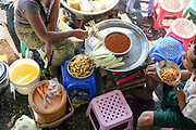 Street food for sale on the platform at Danyingone Station on 16th May 2016 in Yangon, Myanmar. Danyingdone Station is one of the 39 stations on the Yangon Circular Railway, Myanmar. The railway, a narrow gauge local commuter trail network serving Yangon metropolitan area is a 28.5 mile 45.9 km 39 station loop system. This British built rail-loop connects Yangon to its satellite towns and villages