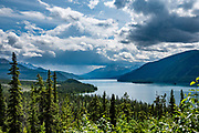 """Muncho Lake Provincial Park, Alaska Highway, British Columbia, Canada. The Alaska Highway was built as a military road during World War II in just 9 months in 1942, to link existing airfields via Canada to the territory of Alaska. The ALCAN Highway (a military acronym for Alaska-Canada) opened to the public in 1948. It begins in Dawson Creek, British Columbia, and runs via Whitehorse, Yukon to Delta Junction, Alaska. The """"Alaskan Highway"""" is comprised of British Columbia Highway 97, Yukon Highway 1 and Alaska Route 2. While the ALCAN measured 2700 kilometers (1700 mi) upon completion in 1942, by 2012 it was rerouted and shortened to 2232 km (1387 mi). Once legendary for being a rough, challenging drive, the highway is now paved over its entire length. Delta Junction, at the end of the highway, claims """"Historic Milepost 1422"""" where the Alaska Highway meets the Richardson Highway, which continues 96 mi (155 km) to the city of Fairbanks at Historic Milepost 1520, often (but unofficially) regarded as the northern portion of the Alaska Highway (although its Mileposts are measured from Valdez)."""