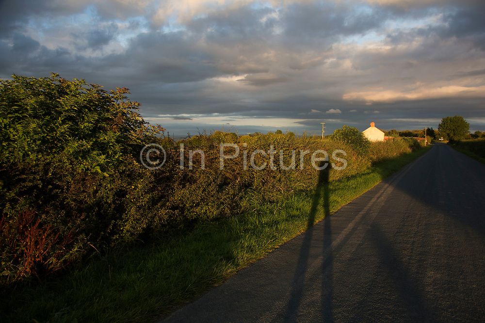 Low sun at sundown over fields in the Hambleton Hills, North Yorkshire, England, UK. The Hambleton Hills are a range of hills which form the western edge of the North York Moors. They are the eastern boundary of the low lying Vale of Mowbray.