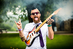© Licensed to London News Pictures. 09/06/2018. Knaresborough UK. James Jones & his smoking guitar who is competing in the Knarsborough bed race today. Knaresborough bed race is taking place today in the town of Knaresborough in Yorkshire. The race first held in 1966 is part fancy dress & part gruelling time trial over a 2.4 mile course ending with a swim through the River Nidd. Photo credit: Andrew McCaren/LNP