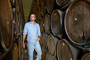 Beto Hernandez, grandson of the founder, inspects tequila aging in the barrel room at the Casa Siete Leguas, El Centenario tequila distillery in Atotonilco de Alto, Jalisco, Mexico. The Seven Leagues tequila distillery is the oldest family owned distillery producing authentic handcrafted tequila using traditional methods.