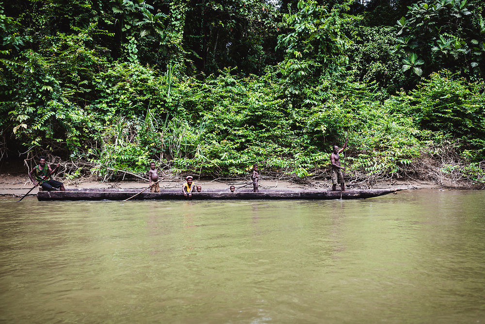 People travel by dugout canoe on the Clay River in Papua New Guinea<br /> <br /> (June 21, 2019)