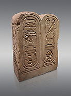 """Ancient Egyptian architectonic element of the temple of Aten, Karnak, limestone, New Kingdom 18th Dynasty (1353-1336 BC). Egyptian Museum, Turin. Grey backcground.<br /> <br /> This crystaline block from the riugn of Amenhoptep IV was part of the railing of the temple of Aten in Karnak. It is os a double form cartouche, which usually enclose the name of the king. Here insted, it contains the names of the sun disk Aten, the one god of King Akhenaten : """"Ra-Harakhty rising in the Horizon"""" """"in the name as the light which is in Aten"""". The name of the king is carved on the sides. The objects is therefore a links god with the pharoah. Drovetti collection Cat 1378 .<br /> <br /> If you prefer to buy from our ALAMY PHOTO LIBRARY  Collection visit : https://www.alamy.com/portfolio/paul-williams-funkystock/ancient-egyptian-art-artefacts.html  . Type -   Turin   - into the LOWER SEARCH WITHIN GALLERY box. Refine search by adding background colour, subject etc<br /> <br /> Visit our ANCIENT WORLD PHOTO COLLECTIONS for more photos to download or buy as wall art prints https://funkystock.photoshelter.com/gallery-collection/Ancient-World-Art-Antiquities-Historic-Sites-Pictures-Images-of/C00006u26yqSkDOM"""