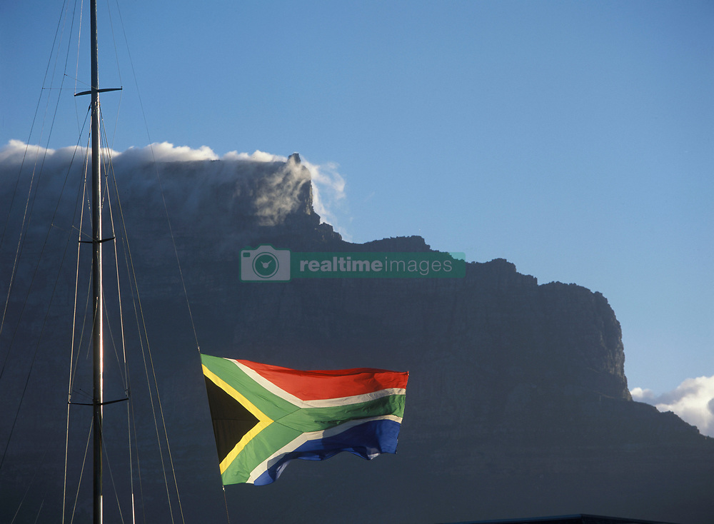 South African flag flying above Victoria and Albert Waterfront with Cape Town and Table Mountain behind, South Africa (Credit Image: © Axiom/ZUMApress.com)