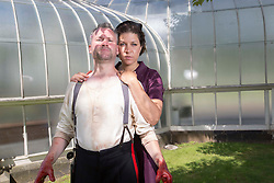 Pictured:   Bard in the Botanics  The latest production features a version of Macbeth set in 1950s, directed by Gordon Barr. Kirk Bage (Macbeth) and Nicole Cooper (Lady Macbeth)  have blood on their hands as they perform the murder of Duncan scene on the main stage<br /> <br /> Karen Gordon  (c) Edinburgh Elite media Date<br /> <br /> <br /> (c) Karen Gordon   Edinburgh Elite media