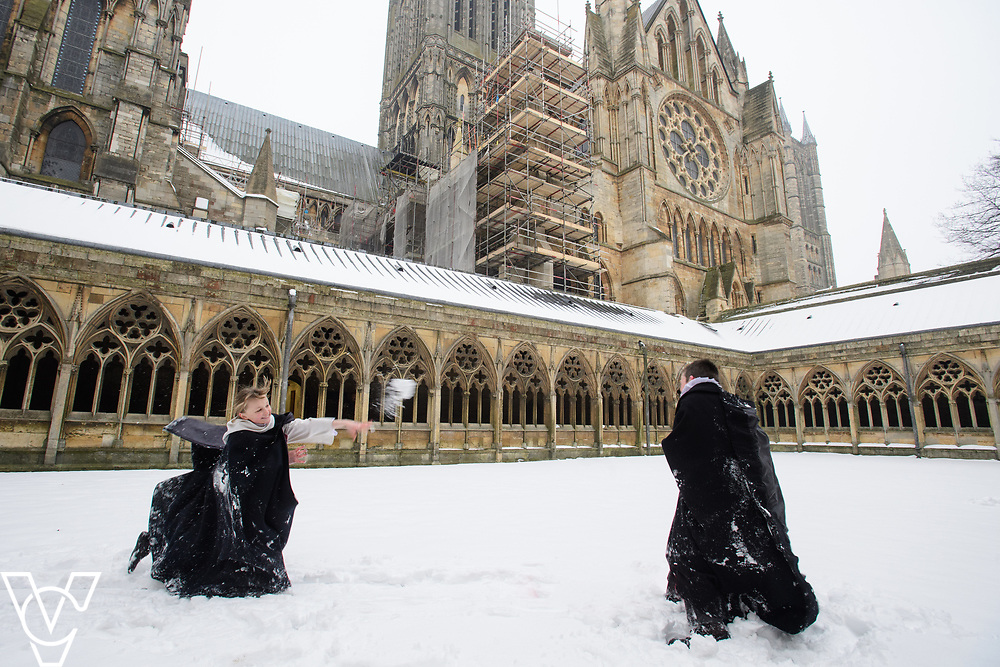 Choristers from Lincoln Cathedral's choir photographed in the snow in the Cloisters area of Lincoln Cathedral.<br /> <br /> Picture: Chris Vaughan Photography for Lincoln Cathedral<br /> Date: March 3, 2018