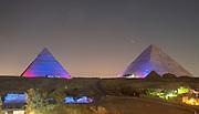 Light show on the Giza Pyramids; Al Haram, Giza Governate, Egypt.