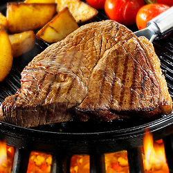 Beef rump steaks and chips being pan fried  on a bbq. Meat food photos, pictures & images.