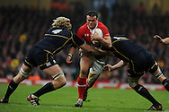 Jamie Roberts of Wales © is stopped by Richie Gray (4). RBS Six nations championship 2012, Wales v Scotland at the Millennium Stadium in Cardiff on Sunday 12th Feb 2012.  pic by Andrew Orchard, Andrew Orchard sports photography,