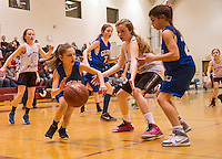 Gilford's Alysen Pichette dribbles around Belmont's Terese Common during the Senior Girls game Saturday afternoon at the 23rd annual Francoeur Babcock Memorial Basketball Tournament at Gilford Middle School.  (Karen Bobotas/for the Laconia Daily Sun)