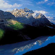 The mighty Canadian Rocky Mountains reflect in Peyto Lake in Banff National Park, Alberta, Canada.