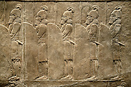 Assyrian relief sculpture panel of soldiers lining the road from the King Ashurnasirpal lion hunt.  From Nineveh  North Palace, Iraq,  668-627 B.C.  British Museum Assyrian  Archaeological exhibit no ME 120859 .<br /> <br /> If you prefer to buy from our ALAMY PHOTO LIBRARY  Collection visit : https://www.alamy.com/portfolio/paul-williams-funkystock/ancient-assyria-antiquities.html  Refine search by adding background colour, place, subject, museum etc into the LOWER SEARCH WITHIN GALLERY box to <br /> <br /> Visit our ANCIENT ASSYRIAN PHOTO COLLECTIONS for more photos to download or buy as wall art prints https://funkystock.photoshelter.com/gallery-collection/Ancient-Assyrian-Art-Artefacts-Antiquities-Historic-Sites-Pictures-Images-of/C0000cjRqQyJjLag