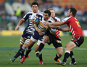 Bryan Habana is tackled by Jano Vermaak and Doppies la Grange during the Super Rugby (Super 15) fixture between the DHL Stormers and the Lions held at DHL Newlands Stadium in Cape Town, South Africa on 26 February 2011. Photo by Jacques Rossouw/SPORTZPICS
