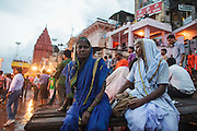 An old couple waiting for a religious cerimony at Dashashwamedh Gath by the Ganges River in Varanasi, India.