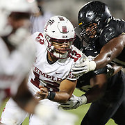 ORLANDO, FL - NOVEMBER 14:  Re-al Mitchell #13 of the Temple Owls escapes the Central Florida Knights defense at Bounce House-FBC Mortgage Field on November 14, 2020 in Orlando, Florida. (Photo by Alex Menendez/Getty Images) *** Local Caption *** Re-al Mitchell