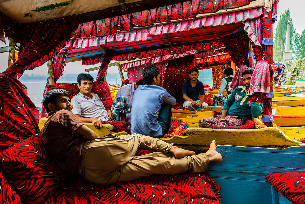 Boatmen relaxing aboard shikaras (boats) at a ghat, Dal Lake, Srinagar, Kashmir, Jammu and Kashmir State, India.