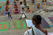 Yoga classes at dawn at Kedar Ghat, along the banks of the sacred Ganges River at Varanasi, Uttar Pradesh.