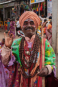 A Hindu man in traditional dress in the Virupaksha temple, in the UNESCO heritage site, ancient, holy village and Temple complex of Hampi on 4th December 2009, Karnataka, India. Hampi is one of Indias most famous landmarks, with numerous Hindu temples from the Vijayanagara Empire. .