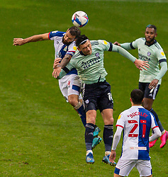 BLACKBURN, ENGLAND - Saturday, October 3, 2020: Cardiff City's Kieffer Moore (R) challenges for a header with Blackburn Rovers' Bradley Johnson during the Football League Championship match between Blackburn Rovers FC and Cardiff City FC at Ewood Park. The game ended in a 0-0 draw. (Pic by David Rawcliffe/Propaganda)